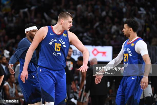 Nikola Jokic of the Denver Nuggets highfives Jamal Murray of the Denver Nuggets against the San Antonio Spurs during Game Five of Round One of the...