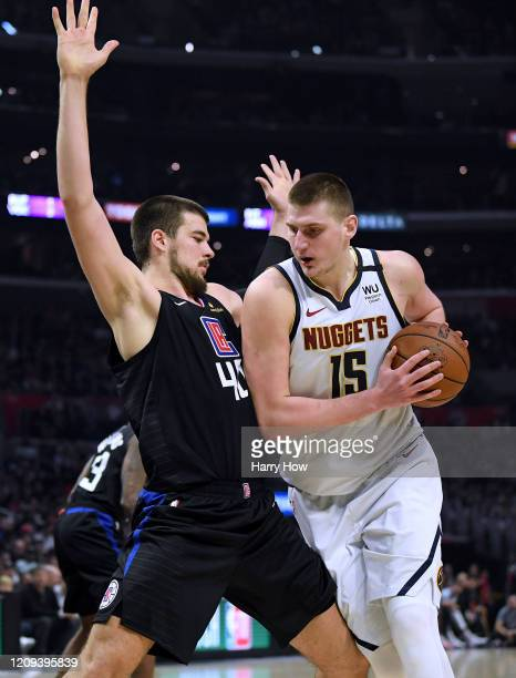 Nikola Jokic of the Denver Nuggets is defended by Ivica Zubac of the LA Clippers during the fourth quarter in a 132-103 Clippers win at Staples...