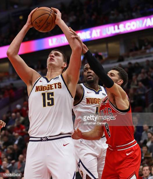 Nikola Jokic of the Denver Nuggets is fouled by Zach LaVine of the Chicago Bulls at the United Center on October 31 2018 in Chicago Illinois The...
