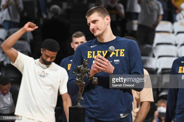 Nikola Jokic of the Denver Nuggets is presented the Maurice Podoloff Trophy as the 2020-2021 Kia NBA Most Valuable Player before the game against the...