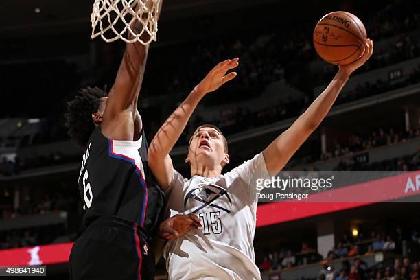 Nikola Jokic of the Denver Nuggets lays up a shot against DeAndre Jordan of the Los Angeles Clippers at Pepsi Center on November 24 2015 in Denver...