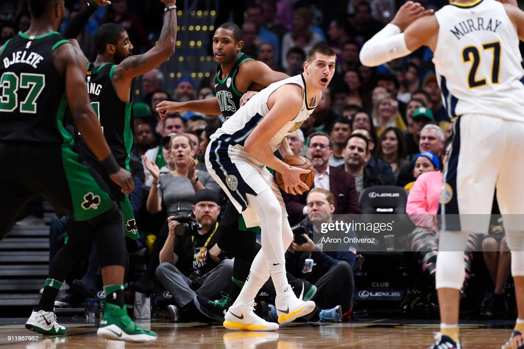 Nikola Jokic (15) of the Denver Nuggets looks for an outlet after grabbing an offensive rebound against the Boston Celtics during the first half on Monday, January 29, 2018. The Denver Nuggets hosted the Boston Celtics at the Pepsi Center in Denver.