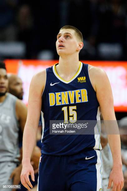 Nikola Jokic of the Denver Nuggets looks on during the game against the Minnesota Timberwolves on April 11 2018 at the Target Center in Minneapolis...
