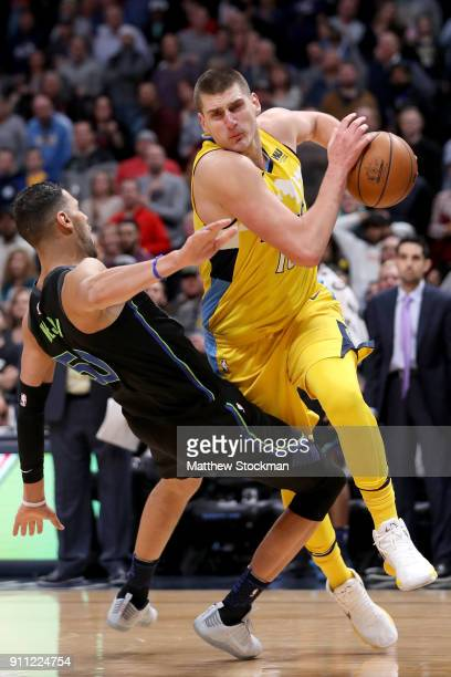 Nikola Jokic of the Denver Nuggets makes an offensive foul late in the fourth period against Salah Mejri of the Dallas Mavericks at the Pepsi Center...