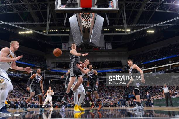 Nikola Jokic of the Denver Nuggets passes against Nemanja Bjelica of the Sacramento Kings on January 3 2019 at Golden 1 Center in Sacramento...