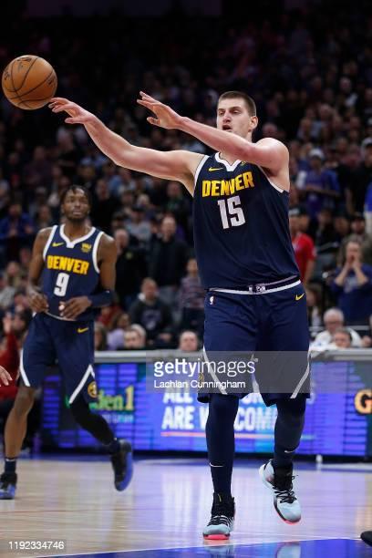 Nikola Jokic of the Denver Nuggets passes the ball against the Sacramento Kings in overtime at Golden 1 Center on November 30, 2019 in Sacramento,...