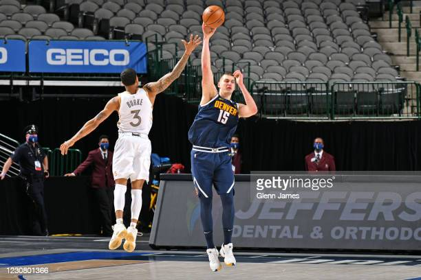 Nikola Jokic of the Denver Nuggets passes the ball down court against the Dallas Mavericks on January 25, 2021 at the American Airlines Center in...