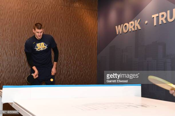 Nikola Jokic of the Denver Nuggets plays ping pong before the game against the Dallas Mavericks on January 27 2018 at the Pepsi Center in Denver...