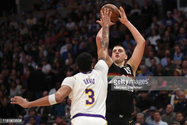 Nikola Jokic of the Denver Nuggets puts up a shot over Anthony Davis of the Los Angeles Lakers in the third quarter at Pepsi Center on December 03...