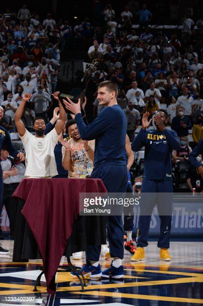 Nikola Jokic of the Denver Nuggets received the Maurice Podoloff Trophy as the 2020-2021 Kia NBA Most Valuable Player before the game against the...