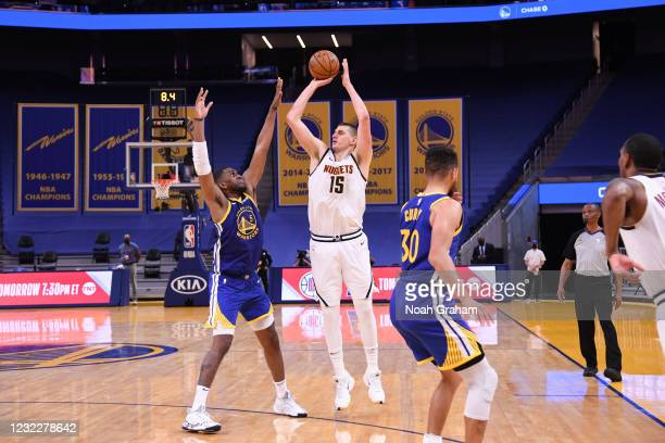 Nikola Jokic of the Denver Nuggets shoots a three point basket during the game against the Golden State Warriors on April 12, 2021 at Chase Center in...