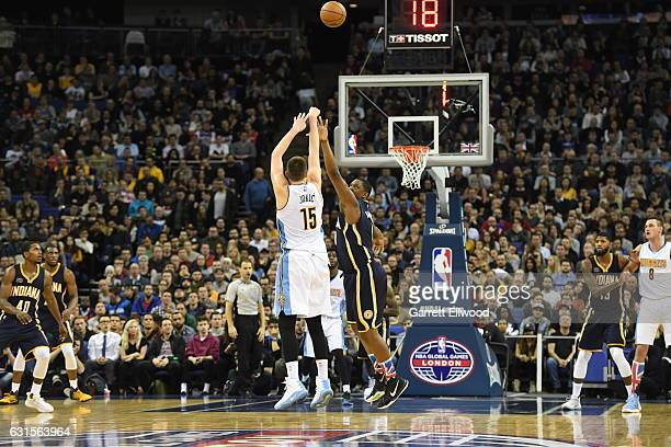 Nikola Jokic of the Denver Nuggets shoots against Kevin Seraphin of the Indiana Pacers as part of 2017 NBA London Global Games at the O2 Arena on...