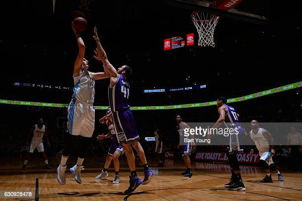 Nikola Jokic of the Denver Nuggets shoots the ball against Kosta Koufos of the Sacramento Kings during the game on January 3 2017 at the Pepsi Center...