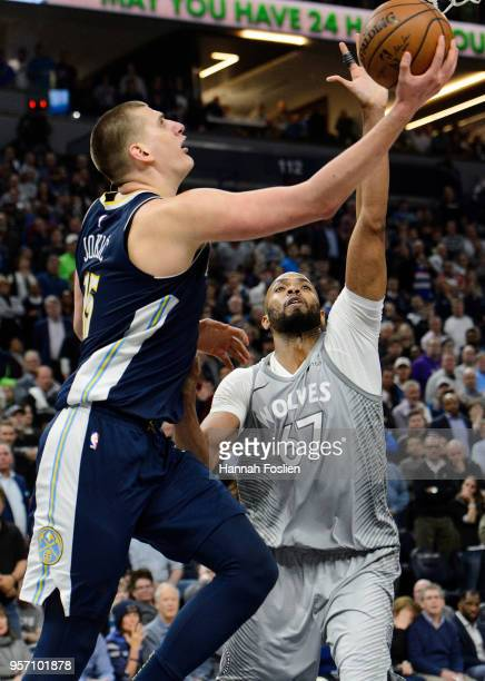 Nikola Jokic of the Denver Nuggets shoots the ball against Taj Gibson of the Minnesota Timberwolves during the game on April 11 2018 at the Target...