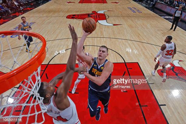 Nikola Jokic of the Denver Nuggets shoots the ball against the Chicago Bulls during a preseason game on October 12 2018 at the United Center in...