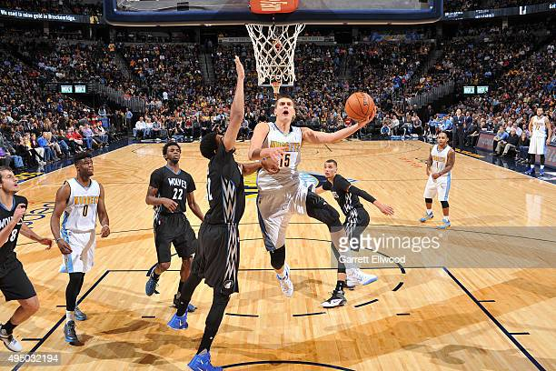 Nikola Jokic of the Denver Nuggets shoots the ball against the Minnesota Timberwolves on October 30 2015 at the Pepsi Center in Denver Colorado NOTE...