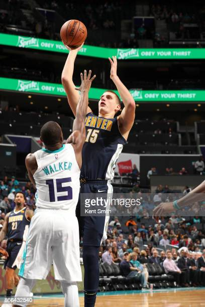 Nikola Jokic of the Denver Nuggets shoots the ball against the Charlotte Hornets on October 25 2017 at Spectrum Center in Charlotte North Carolina...