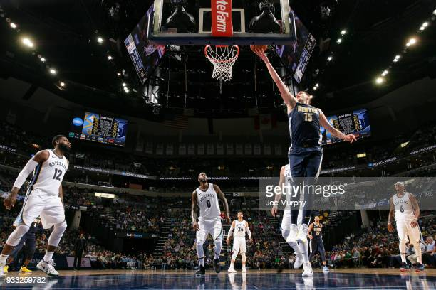 Nikola Jokic of the Denver Nuggets shoots the ball against the Memphis Grizzlies on March 17 2018 at FedExForum in Memphis Tennessee NOTE TO USER...