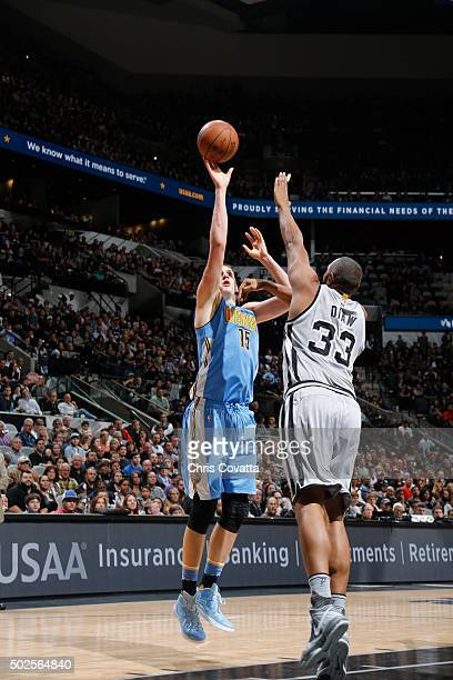Nikola Jokic of the Denver Nuggets shoots the ball against the San Antonio Spurs on December 26 2015 at the ATT Center in San Antonio Texas NOTE TO...
