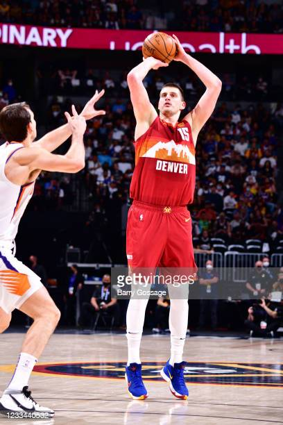 Nikola Jokic of the Denver Nuggets shoots the ball against the Phoenix Suns during Round 2, Game 4 of the 2021 NBA Playoffs on June 13, 2021 at the...