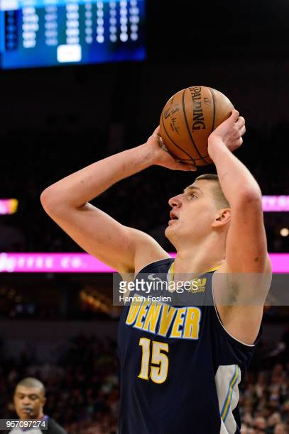 Nikola Jokic of the Denver Nuggets shoots the ball against the Minnesota Timberwolves during the game on April 11 2018 at the Target Center in...