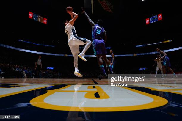 Nikola Jokic of the Denver Nuggets shoots the ball during the game against the Charlotte Hornets on February 5 2018 at the Pepsi Center in Denver...