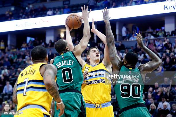 Nikola Jokic of the Denver Nuggets shoots the ball during the game against the Boston Celtics on March 10 2017 at Pepsi Center in Denver Colorado...