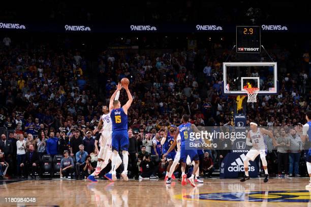Nikola Jokic of the Denver Nuggets shoots the game-winning sho against the Philadelphia 76ers on November 8, 2019 at the Pepsi Center in Denver,...