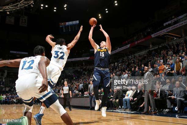 Nikola Jokic of the Denver Nuggets shoots the shot to win the game against the Minnesota Timberwolves on November 10, 2019 at Target Center in...