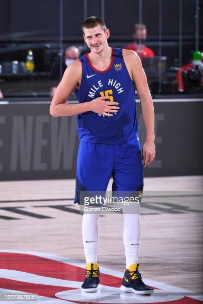 Nikola Jokic of the Denver Nuggets smiles during the game against the Utah Jazz on August 8, 2020 at AdventHealth Arena at ESPN Wide World of Sports...
