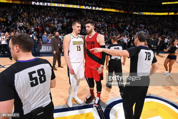 Nikola Jokic of the Denver Nuggets speaks to Jusuf Nurkic of the Portland Trailblazers during the game between the two teams on APRIL 9 2018 at the...