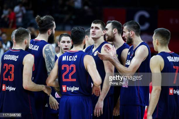Nikola Jokic of the Serbia National Team celebrates with team mates after winning over the Angola National Team during the 1st round of 2019 FIBA...