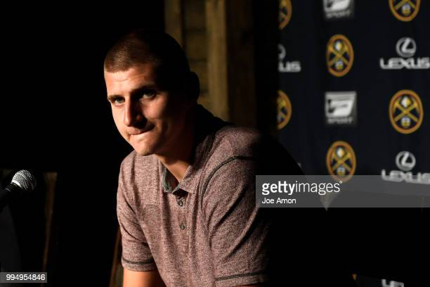 Nikola Jokic waiting for the start of a press conference for Josh Kroenke vice chairman of Kroenke Sports and Entertainment and the Nuggets announce...