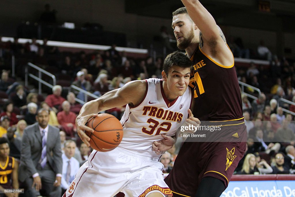 Nikola Jovanovic #32 of the USC Trojans drives to the basket against Eric Jacobsen #21 of the Arizona State Sundevils during a NCAA Pac12 college basketball game at Galen Center on January 7, 2016 in Los Angeles, California.