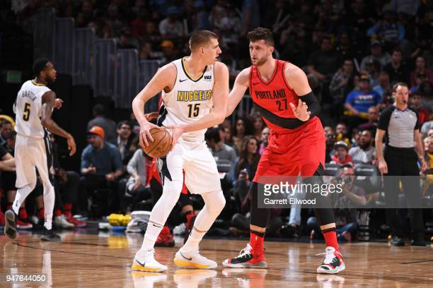 Nikola Jovis of the Denver Nuggets handles the ball against Jusuf Nurkic of the Portland Trail Blazers on APRIL 9 2018 at the Pepsi Center in Denver...