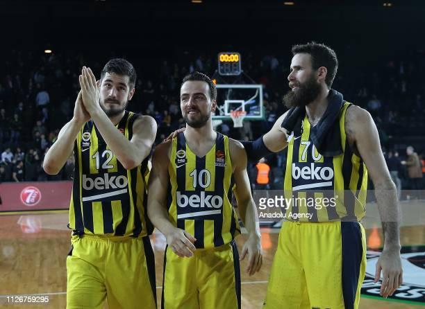 Nikola Kalinic Melih Mahmutoglu and Luigi Datome of Fenerbahce Beko celebrate 9775 win against Darussafaka Tekfen after the Turkish Airlines Week 23...