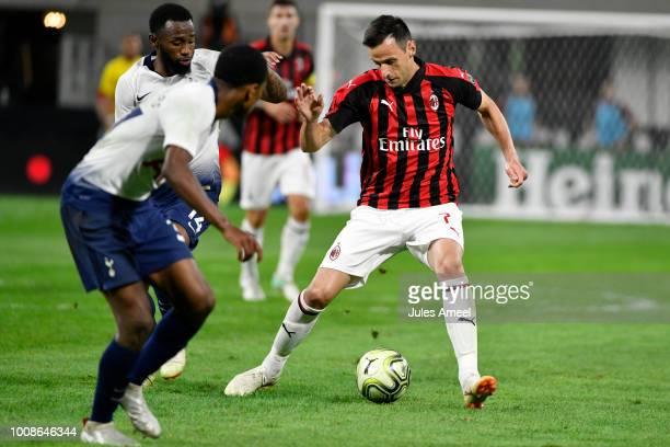 Nikola Kalinic of AC Milan advances the ball past Georges-Kévin N'Koudou of the Tottenham Hotspur during the second half of the International...