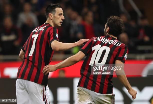 Nikola Kalinic of AC Milan celebrates his goal with his team-mate Hakan Calhanoglu during the serie A match between AC Milan and US Sassuolo at...