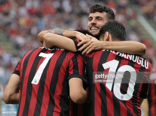 Nikola Kalinic of AC Milan celebrates his goal with his teammates Patrick Cutrone and Hakan Calhanoglu during the Serie A match between AC Milan and...