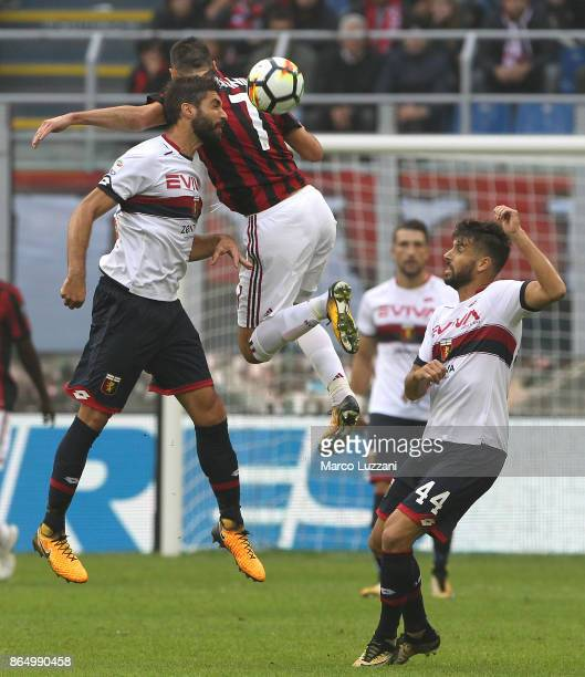 Nikola Kalinic of AC Milan competes for the ball with Luca Rossettini and Miguel Veloso of Genoa CFC during the Serie A match between AC Milan and...
