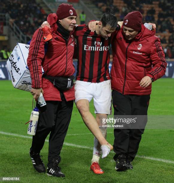 Nikola Kalinic of AC Milan leaves the pitch injured during the TIM Cup match between AC Milan and FC Internazionale at Stadio Giuseppe Meazza on...
