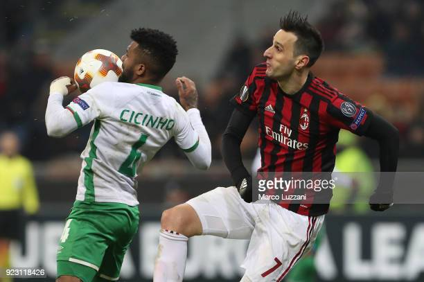 Nikola Kalinic of AC Milanis competes for the ball with Cicinho of Ludogorets Razgrad during UEFA Europa League Round of 32 match between AC Milan...