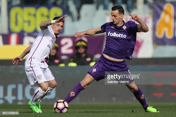 Nikola Kalinic of ACF Fiorentina battles for the ball with Fabio Pisacane of Cagliari Calcio during the Serie A match between ACF Fiorentina and...