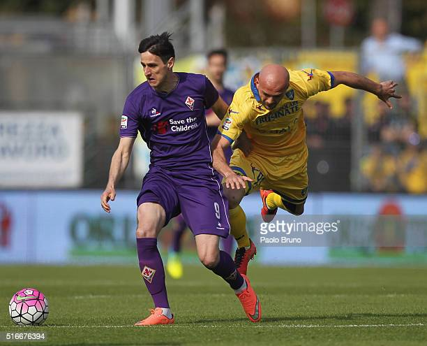 Nikola Kalinic of ACF Fiorentina competes for the ball with Arlind Ajeti of Frosinone Calcio during the Serie A match between Frosinone Calcio and...