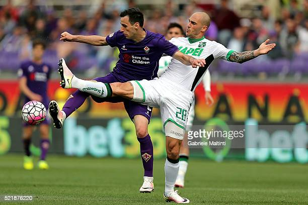Nikola Kalinic of ACF Fiorentina in action against Paolo Cannavaro of US Sassuolo Calcio during the Serie A match between ACF Fiorentina and US...