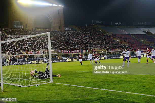 Nikola Kalinic of ACF Fiorentina scores the opening goal from the penalty spot during the Serie A match betweenBologna FC and ACF Fiorentina at...