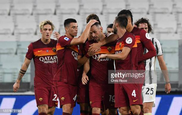 Nikola Kalinic of AS Roma celebrates goal with teammates during the Serie A match between Juventus and AS Roma at on August 1, 2020 in Turin, Italy.