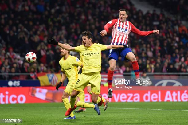Nikola Kalinic of Atletico and Bernardo Espinosa of Girona FC in action during the Copa del Rey Round of 16 match between Atletico Madrid and Girona...