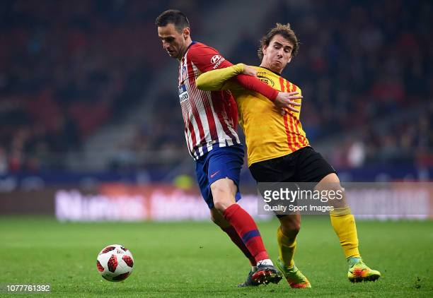 Nikola Kalinic of Atletico de Madrid competes for the ball with Jaume Villar of Sant Andreu during the Spanish Copa del Rey second leg match between...