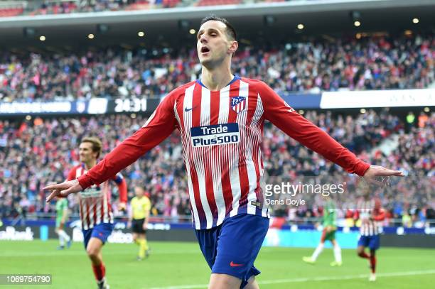 Nikola Kalinic of Atletico Madrid celebrates after scoring his team's first goal during the La Liga match between Club Atletico de Madrid and...